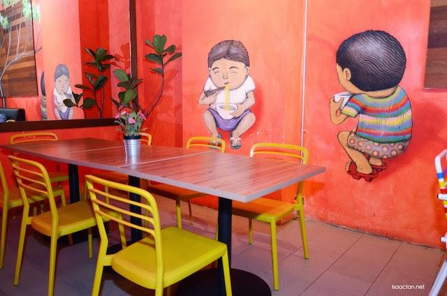 Interesting art adorn the walls of Chili ESPRESSO