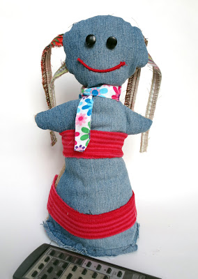 Rag doll repurposed from fabric scraps, denim and burlap