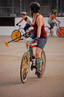 lady playing bike polo