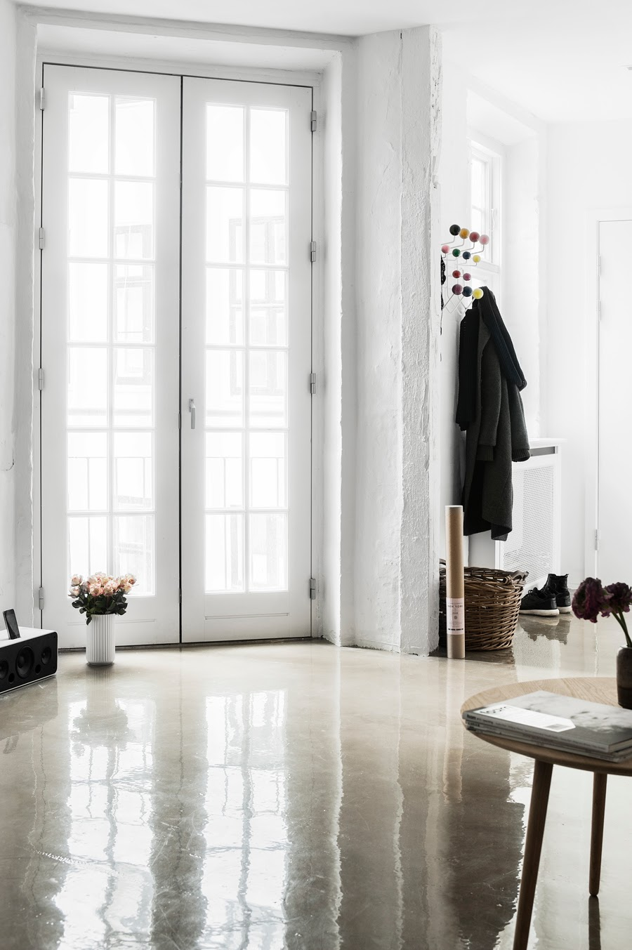 foyer with french doors glossy shiny concrete floors