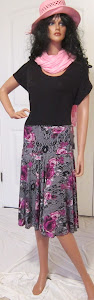 Full Circle skirt with magenta roses on a black background