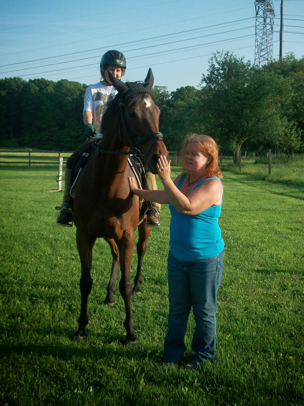Me standing next to Patty on her horse