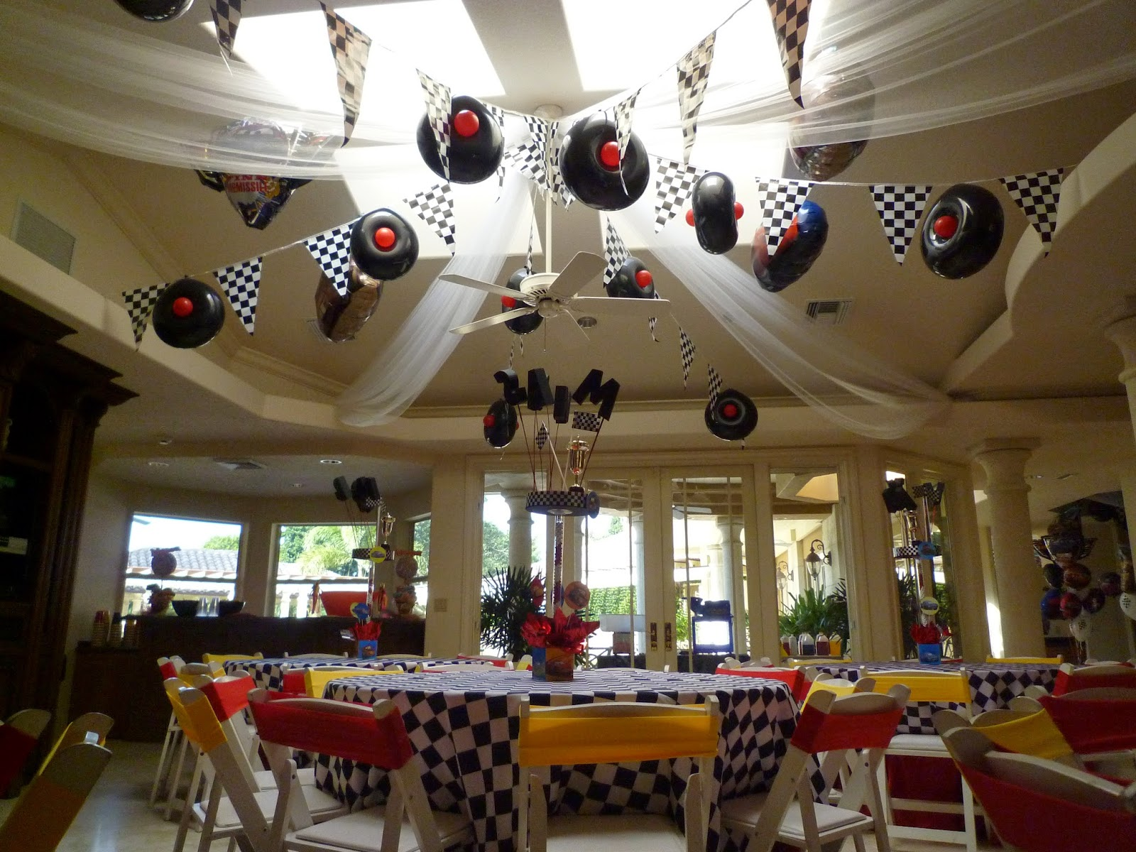 Dreamark events blog disney cars theme decor with cars for Baby shower ceiling decoration ideas