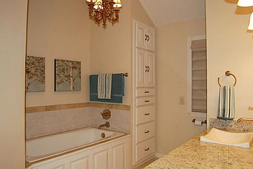 pretty benjamin moore revere pewter bathroom. We painted the cabinetry  Pure White Sherwin Williams and walls Revere Pewter Benjamin Moore Above tub we hung a giant mirror from Home Goods The Happy Homebodies One Year Later Progress Report