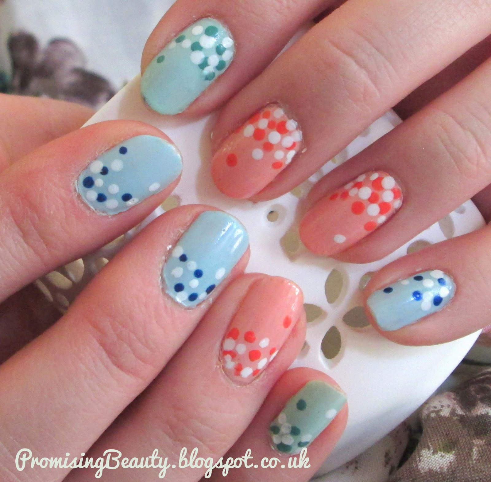 Summertime manicure, polka dots and spots in springtime pastel shades, mint green light blue and coral orange. Finished nail look. Nail art in pastel for spring and summer 2015 style and on trend. Nail trend.