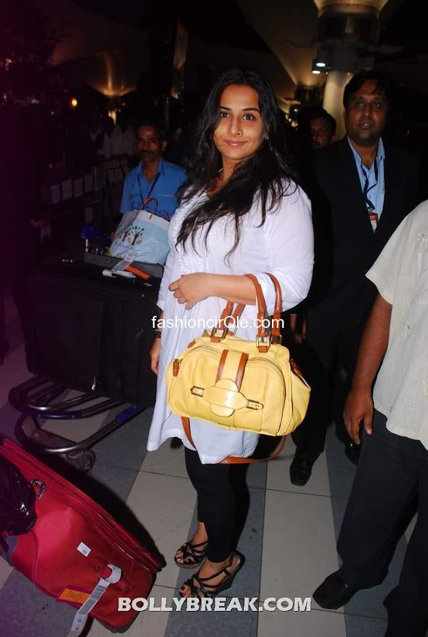 Vidya balan yellow purse - Vidya balan returning from IIFA 2012