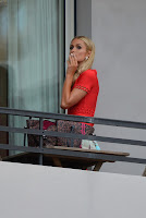 Paris Hilton smoking on the balcony of her Cannes hotel
