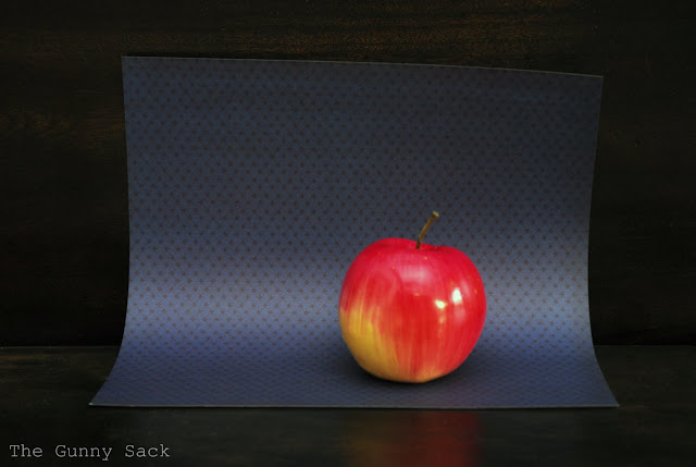 Apple On Blue Paper