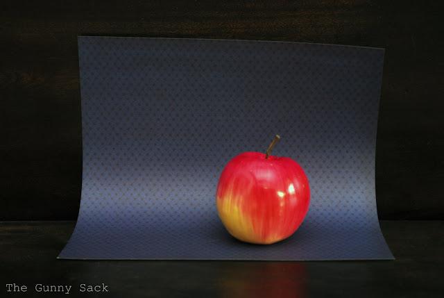 Apple On Blue Paper