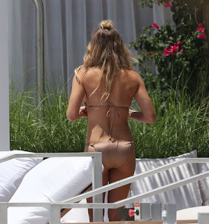 LeAnn Rimes, 32, exploded her amazing anatomy in a brown string bikini as she relaxing alone at the pool in Miami, FL, USA on Sunday, July 19, 2015.