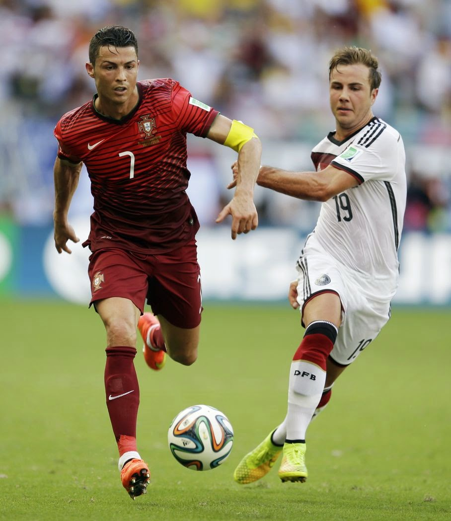 Portugal's Cristiano Ronaldo (7) races past Germany's Mario Goetze (19) during the group G World Cup soccer match between Germany and Portugal at the Arena Fonte Nova in Salvador, Brazil, Monday, June 16, 2014.