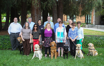 GDB Alumni Association Board stands on campus with Director of Training Brad Hibbard.