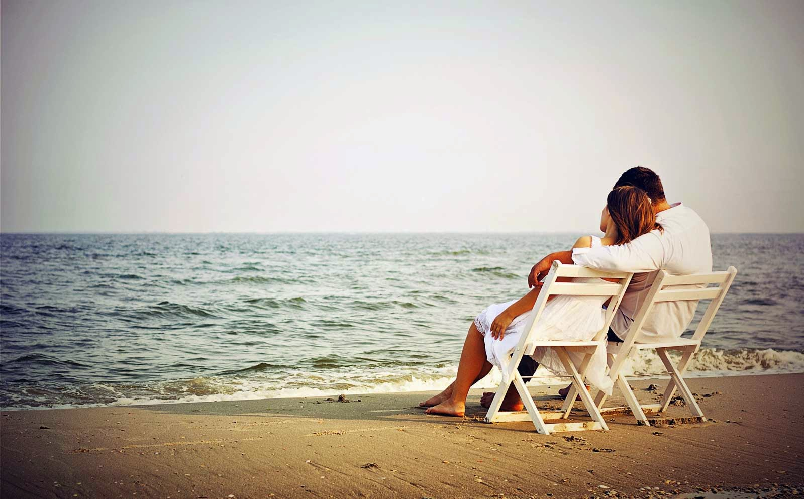 Romantic Couple Enjoying the Beauty of Sea