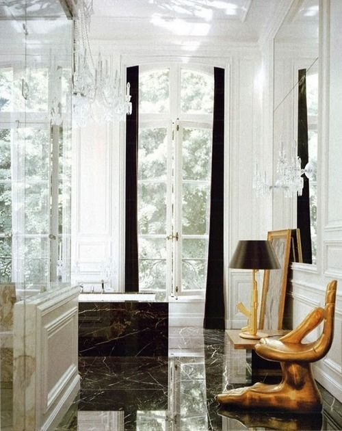 Lenny Kravitz black marble bathroom with hand chair