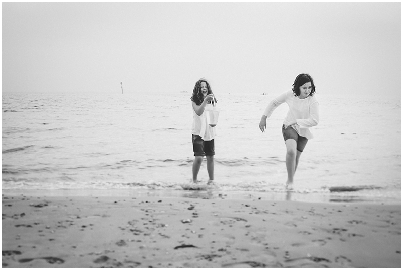 Sisters playing in the sea
