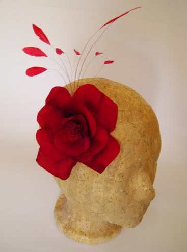red silk rose with feathers