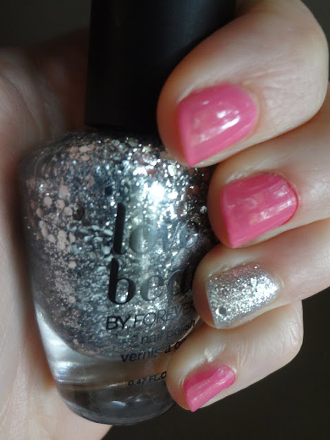 silver glitter accent nail with pink polish