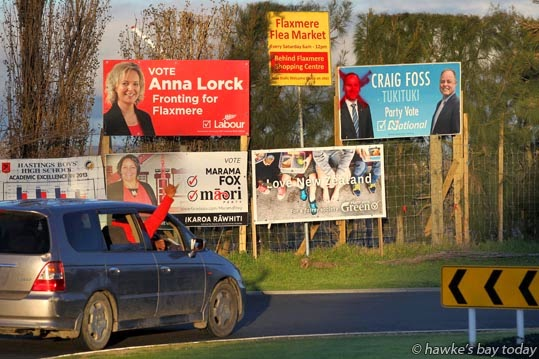 Election billboard damage, vandalism, on corner of Wilson Rd and Flaxmere Ave, Flaxmere, Hastings - four billboards on the corner, only one damaged, a billboard of John Key, PM, and Craig Foss, National Party candidate for Tukituki electorate. photograph