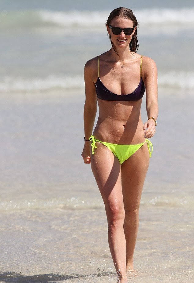 Julie Henderson displays a Yellow Bikini as she shares a romance in Miami
