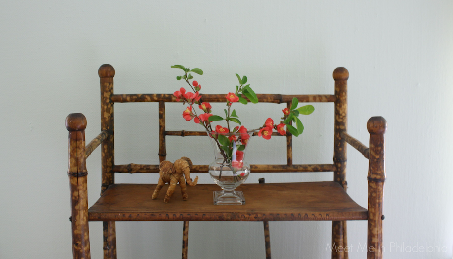 quince sprigs on bamboo etagere via Meet Me in Philadelphia