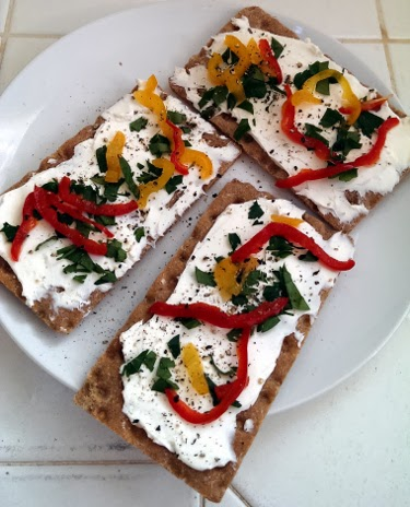 crispbread with cream cheese, pickled peppers, and parsley