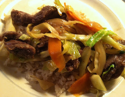 Stir-Fried Steak with cabbage and carrots served over rice
