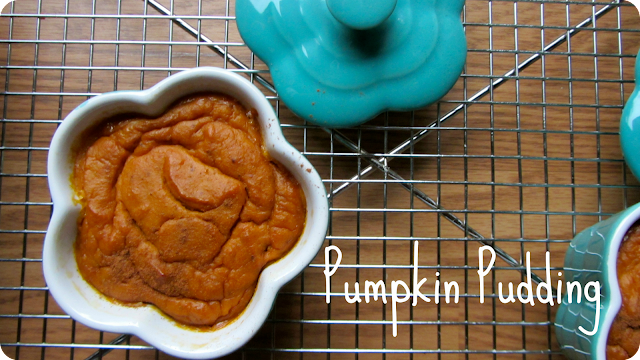 pumpkin pudding in turquoise ramekins cooling on a wire rack