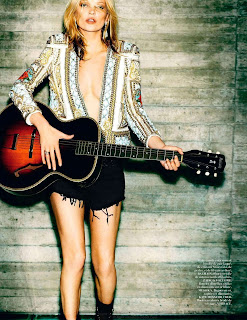 Kate Moss playing a guitar