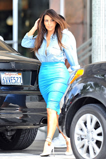 Kim Kardashian looking sexy in a blue skirt