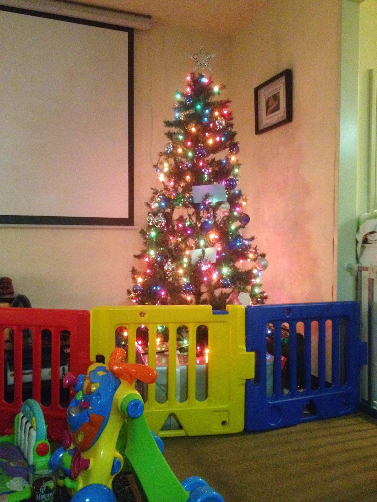 im sure you are all eager to hear about her first christmas we had the tree protected by a baby gate which for the most part was sufficient - Baby Gate For Christmas Tree