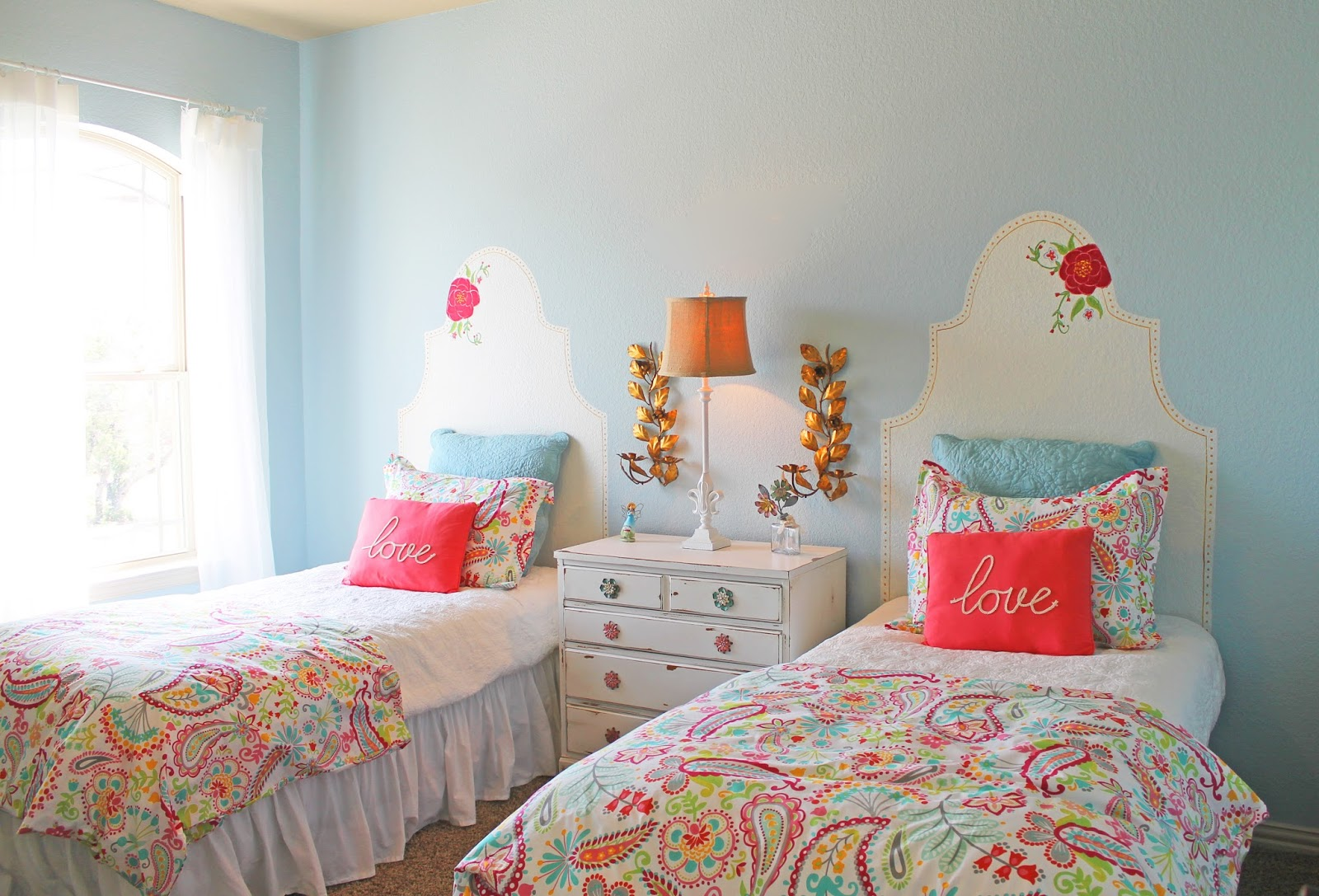 the twin girls room how fun is this i painted headboards on the