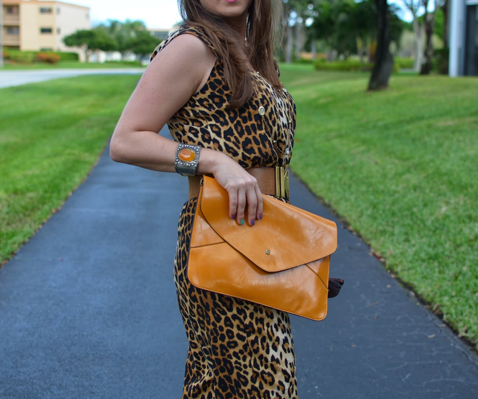 Leopard jumpsuit - envelope clutch - statement cuff