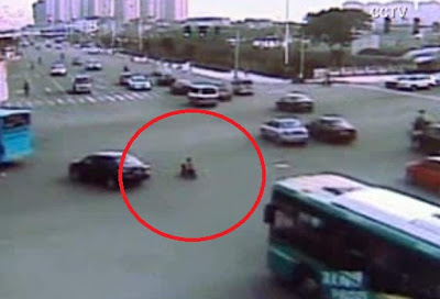 Child in China Rides Toy Motorbike Onto Busy Road