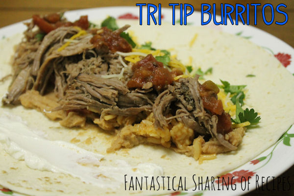 Tri Tip Burritos | Slow-cooked shredded beef paired with refried beans, rice, and cilantro. #recipe