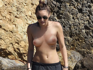 Miley Cyrus topless on the beach
