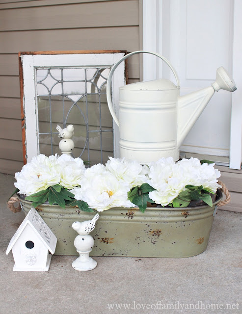 Olive Metal Planter with Floral Arrangements via Kirkland's