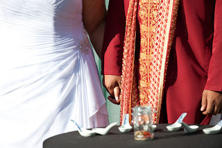 Tameka and Manoj hold hands after Spice Ceremony at their wedding