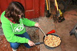 girl cooking on camping stove