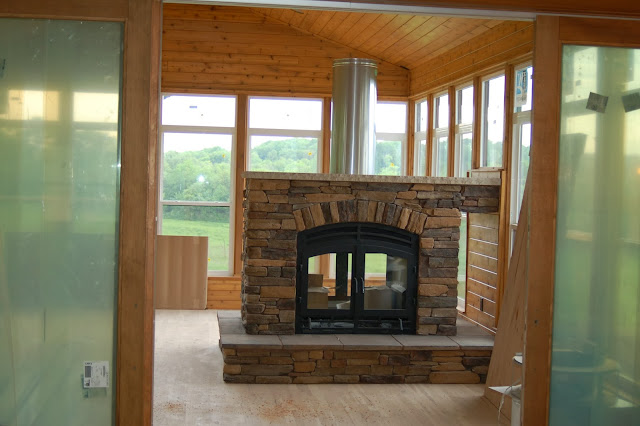 Acucraft Fireplaces See Through Wood Fireplace With Exposed Flue