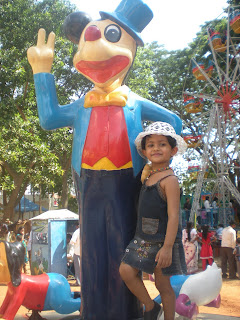 baby girl with mickey mouse at bannerghatta park