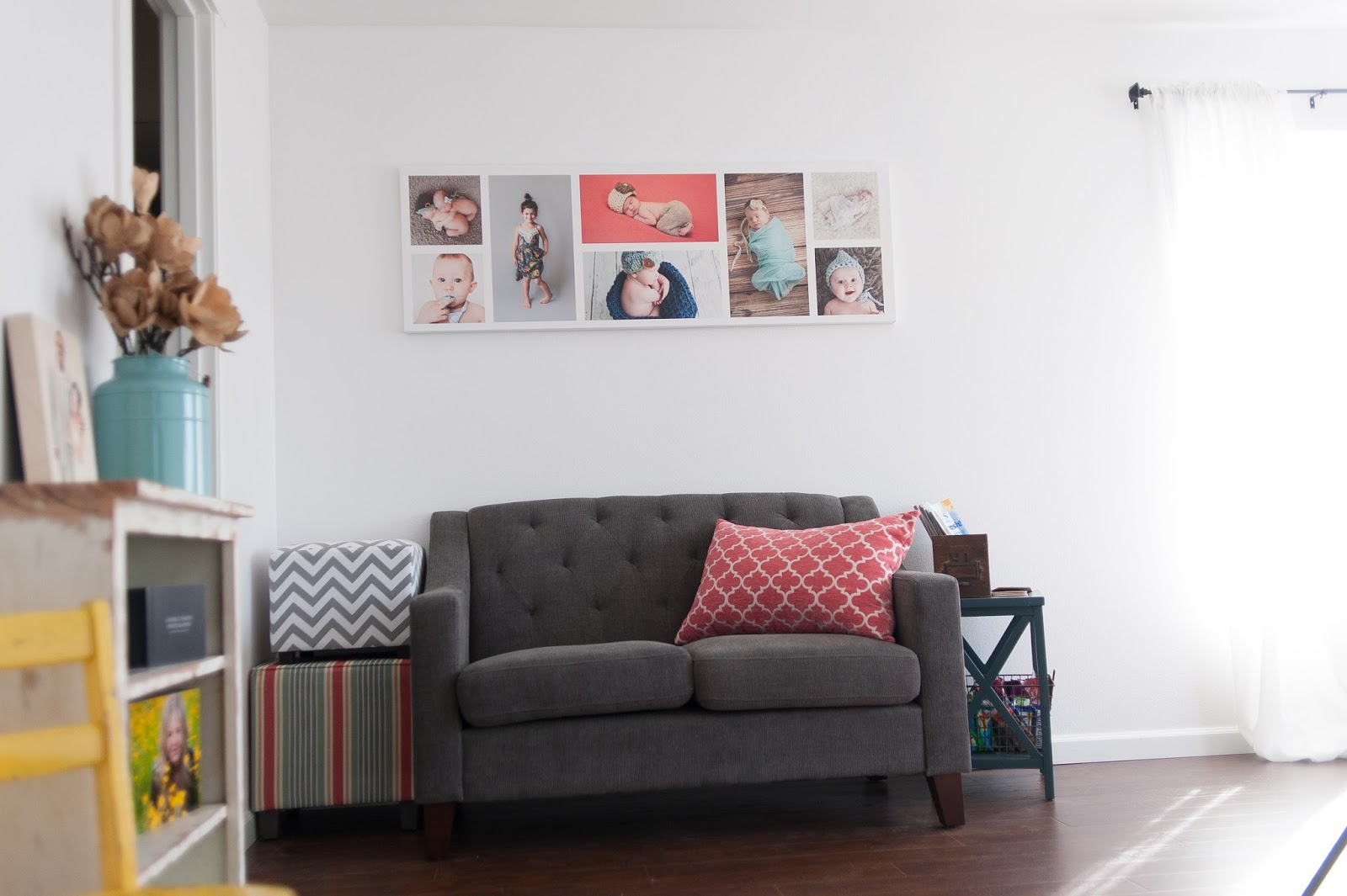 Gray Love seat,colorful accents. White Walls and hardwood floors
