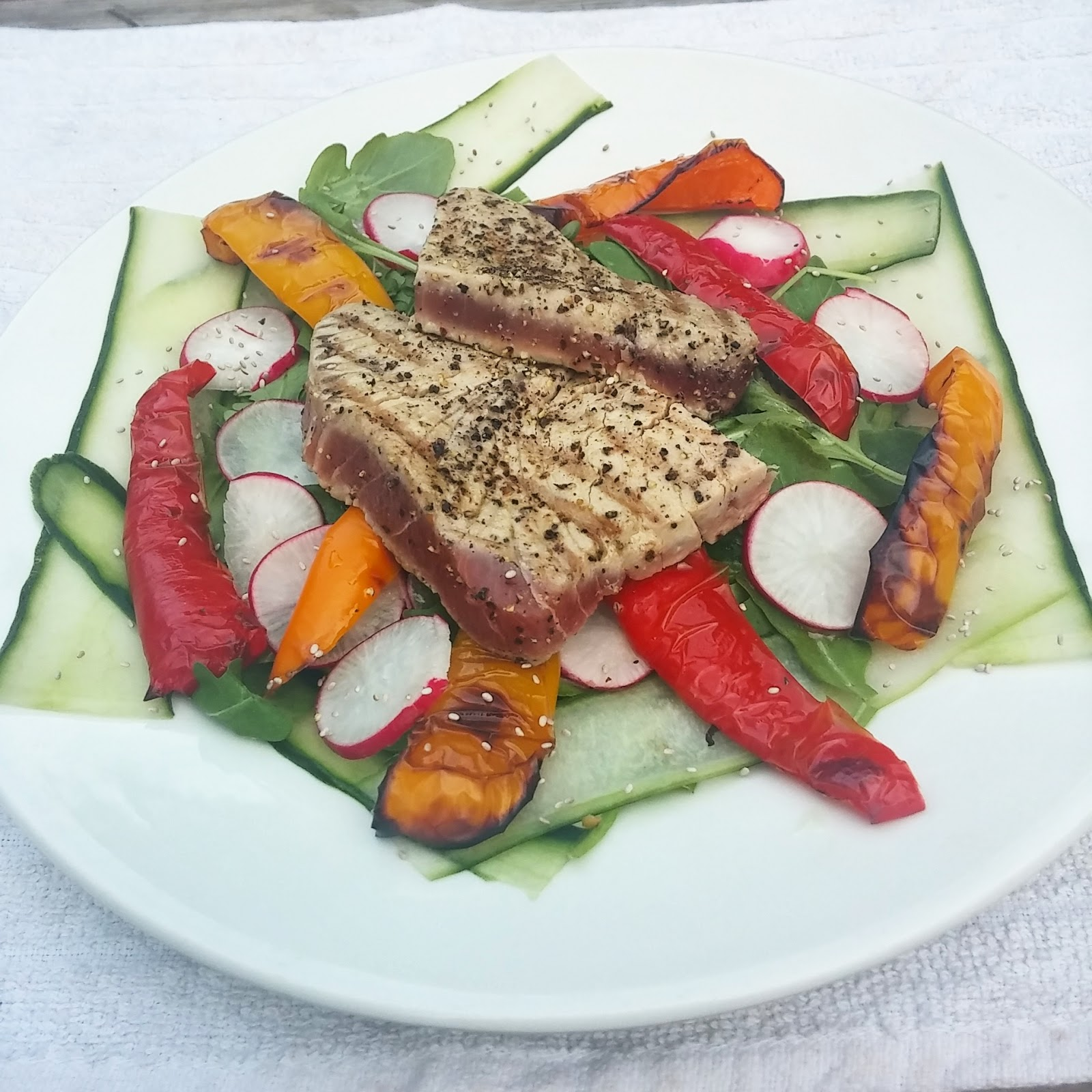 smoky sweet peppers, peppery rocket and radishes, lemon and cider vinegar dressing under a perfectly cooked rare tuna steak