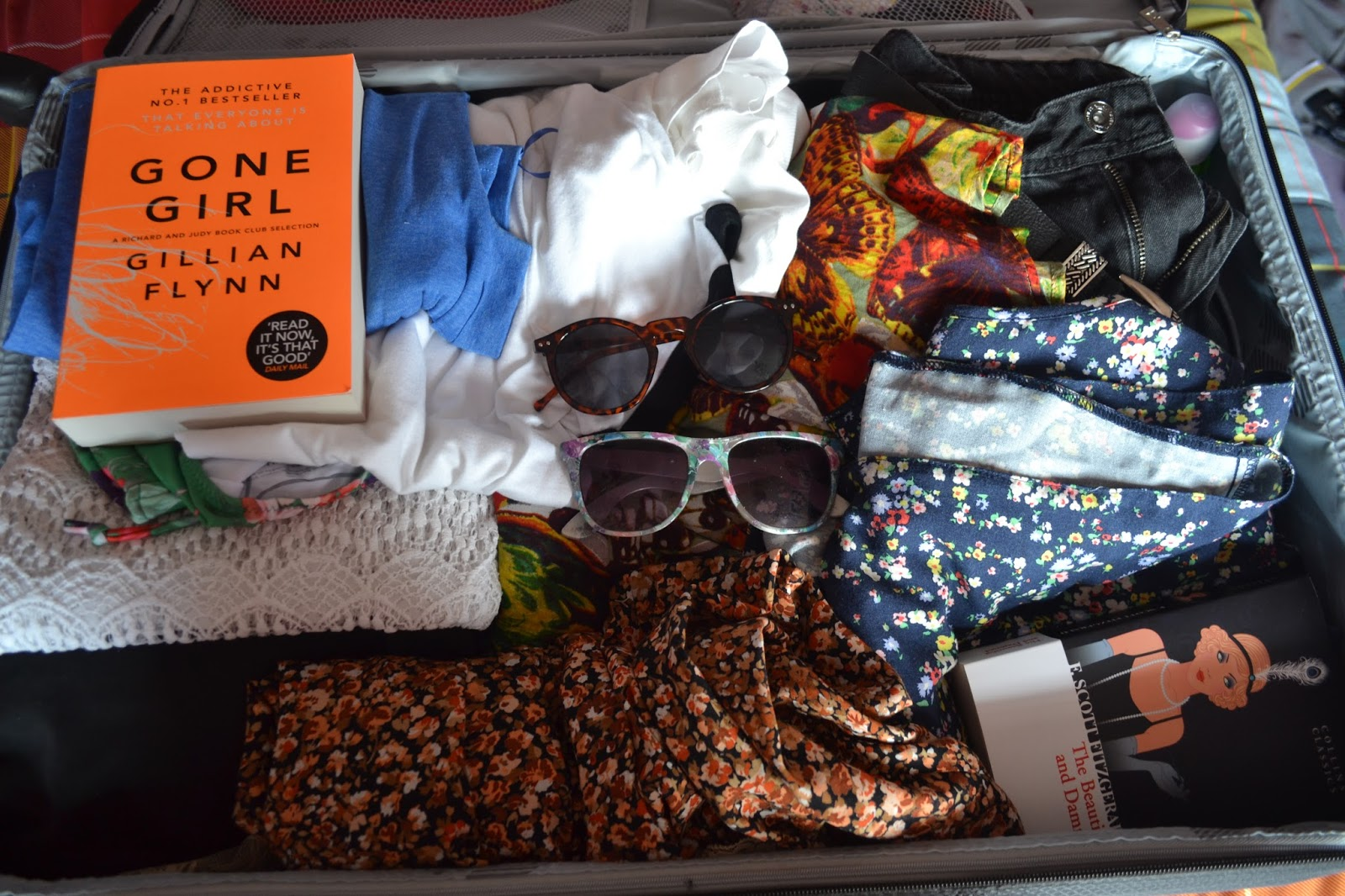 Inside my suitcase: sunglasses, gone girl, the beautiful and damned