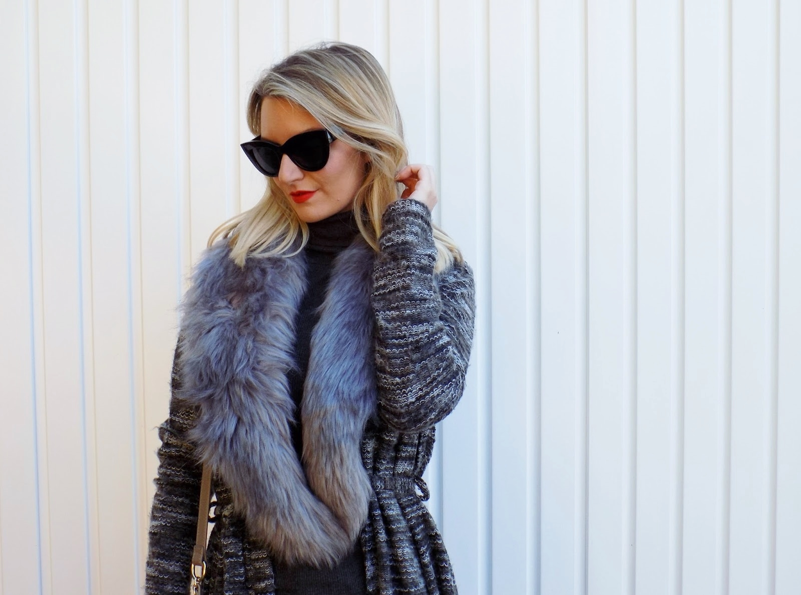 close up of faux fur collar on cardigan