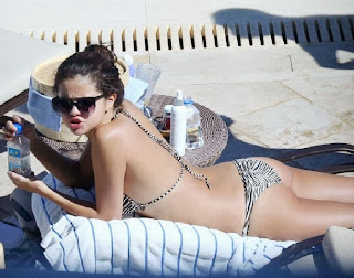 Selena Gomez wearing a Zebra Bikini and Tattoo in Miami