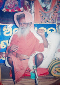 baba singing son at bhajan mandap