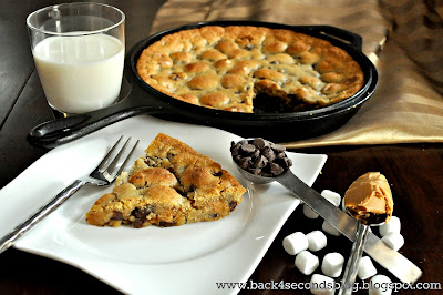 Deep Dish Chocolate Chip Cookie Pie - Ooey gooey with peanut butter and marshmallow filling!! http://backforsecondsblog.com #cookiepie #peanutbutter #pie #castironskillet