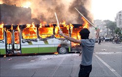 Protester burns a bus