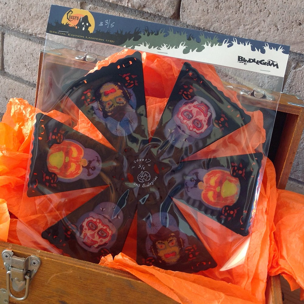 Collapsible vintage-style German-esque Halloween decoration for eerie lighting displays in your home.