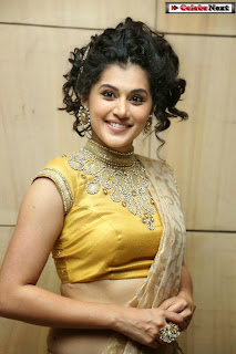 Actress Tapsee Pannu Pictures in Golden Saree at Elite Designer Fashion Show 0021